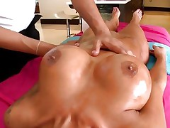 Excited Angelina Valentine has her love bubbles rubbed with oil
