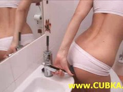 Nice-looking golden-haired dildoing in toilet