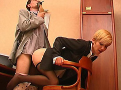 Slutty co-worker sniffing high heel shoes whilst fucking sexy gal in dark hose