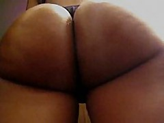 This amateur ebon chick has a flawless round butt, it looks even more excellent with her dark strap on, and the way she's flexing it in this clip makes everybody drool.