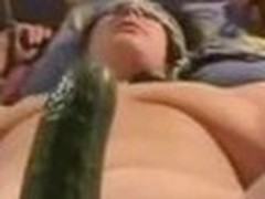 Tied up wife getting drilled with a large cucumber