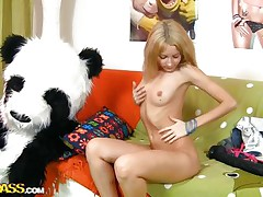 Russian blonde cutie is bored and wants some fun! Her name is Sveta, a slender hottie with a youthful hot body that burns with lust for a hard fuck. At 1st this sweetheart widen these hot legs and rubbed her vagina but that was not sufficiently so now this sweetheart sucks and rides her panda bear. What a wicked girl, panda should chastise her!
