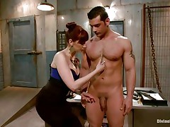 Divine redhead dominatrix-bitch enjoys punishing a muscled guy like this one. That babe takes her time and does the job with precision. At first the doxy uses a lot of laundry pliers on this dude's knob and when she finishes she goes in the back of the room, wonder why?