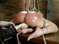 Oiled up blond is bound up and has a hook in her anus. That playgirl is getting her vagina fingered hard by this women and this playgirl is bursting with fun as this playgirl fingers her deeper and deeper while using that dildo on her clitoris. These oiled sexy thighs are widen and bound very hard and u can clearly watch that cum asking shaved vagina betwixt them. In the next scene she's hanging with her sexy legs widen even wider, what do u think this playgirl will endure?