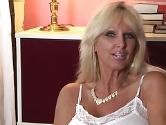 mature whores from usa are known to be sexy and naughty. Here we have Tia Gunn, a blond bitch with giant boobs and a lewd face that can give any fellow an erection. She takes out her melons after a short talk and taunts us with 'em by squeezing 'em hard. Do u think this playgirl deserves a cock betwixt her breasts and some semen?