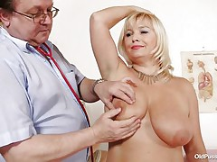 This blonde wench is absolutely naked at the doctor. The doctor begins examining her large titties with large and hawt nipples. After that that chap takes her pulse. The mature honeys is sitting on the sofa now with her large a-hole at the doctor. That chap begin inspects her a-hole and large shaved twat from behind.