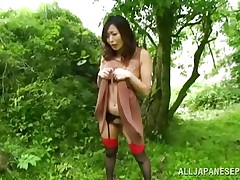 Nature loving Nippon hotty is receiving her dose of wilderness! This cute slut has her hands tied on a tree branch and receives roughly drilled from behind. Her moans and screams won't help her 'cuz there's nobody around. Look at that sweet vagina being rubbed with a vibrator and then drilled hard.