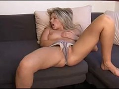 Blonde chick fingers lustily during the time that on the sofa